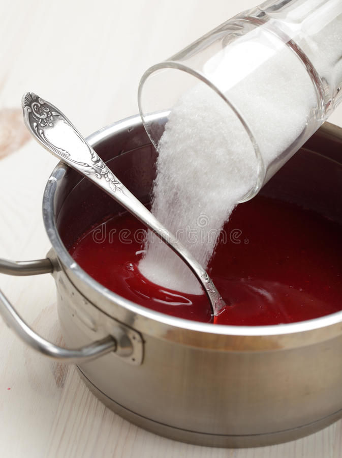 Cooking red currant jelly stock image