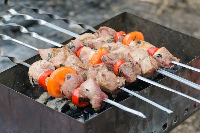 Cooking roast shish kebab on coals stock photo