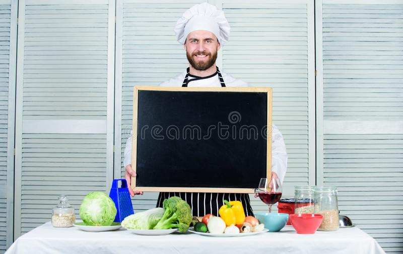 Cooking school lesson. Master cook giving cooking class. Chief cook teaching master class in cooking school. Education royalty free stock photos