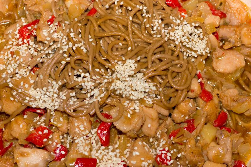Cooking soba with vegetables and chicken stock images