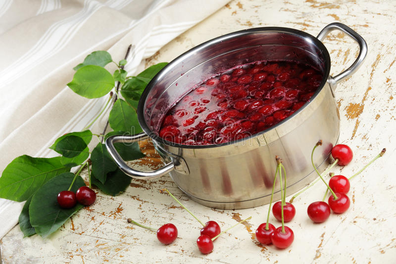 Cooking sour cherry jam stock image