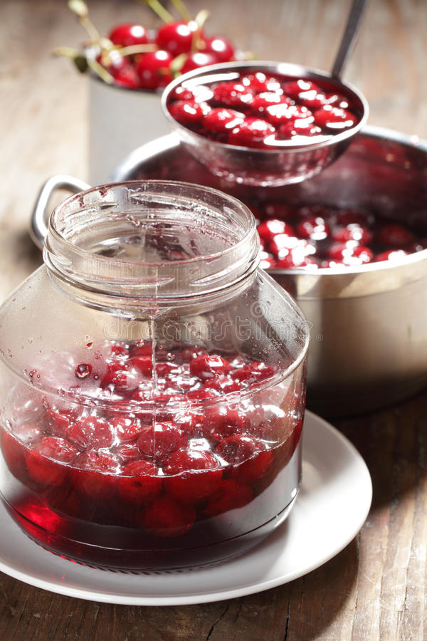 Cooking sour cherry jam stock photography