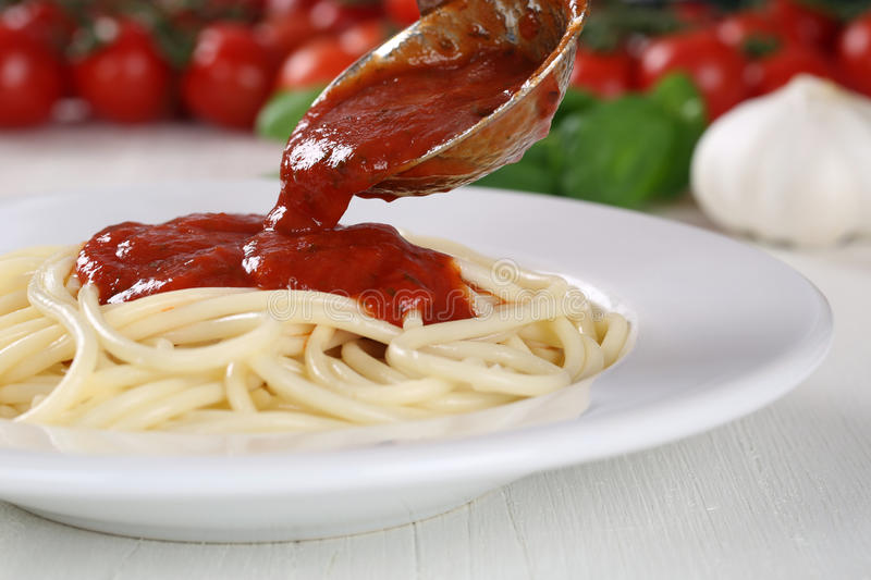 Cooking spaghetti noodles pasta: serving tomato sauce Napoli royalty free stock images