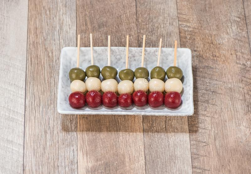 The cooking step of making Japanese Dango dessert. With 3 different color in pinkred, white, and green, recipe, hanami Dango, tsukimi Dango, copy space royalty free stock photos