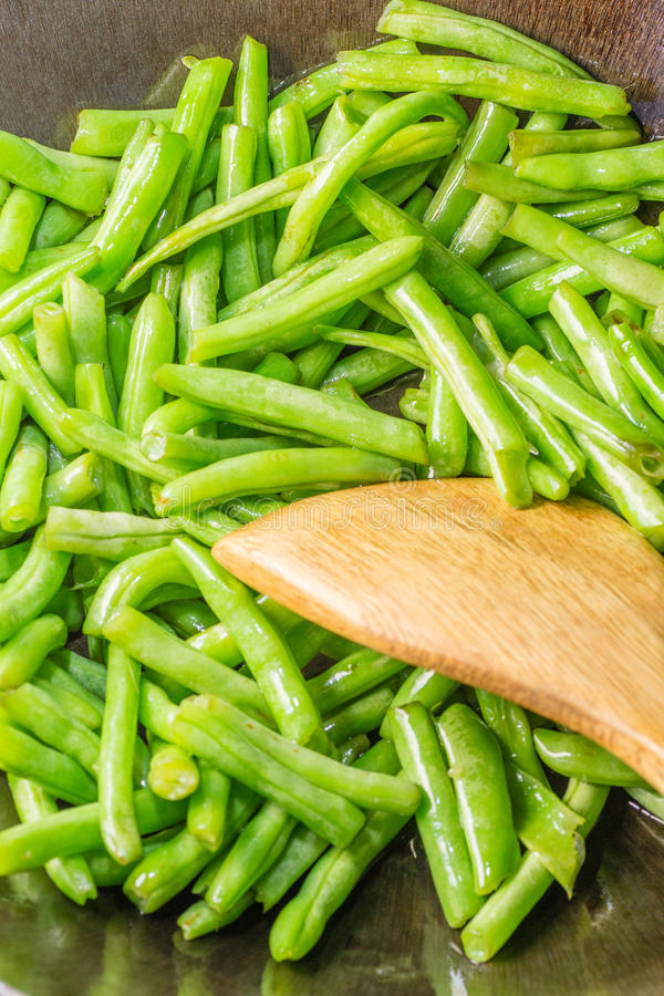Cooking string bean. In the pot royalty free stock image