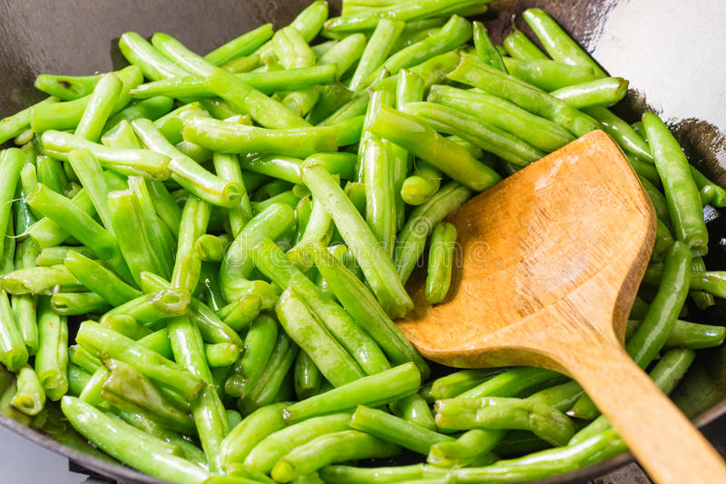 Cooking string bean. In the pot royalty free stock photography