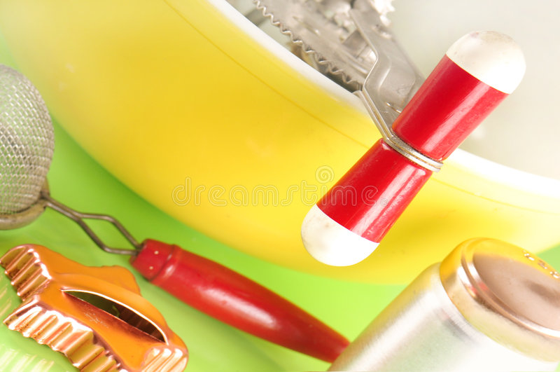 Cooking supplies. Bowl and baking supplies in kitchen royalty free stock photo