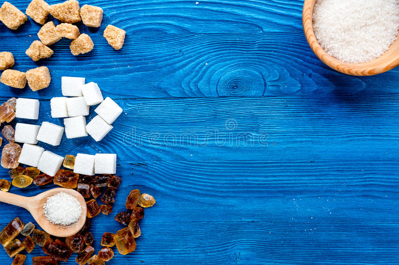 Cooking sweets set with sugar in bowls on kitchen table background top view mock-up. Cooking sweets set with sugar in bowls on kitchen blue table background top royalty free stock photo