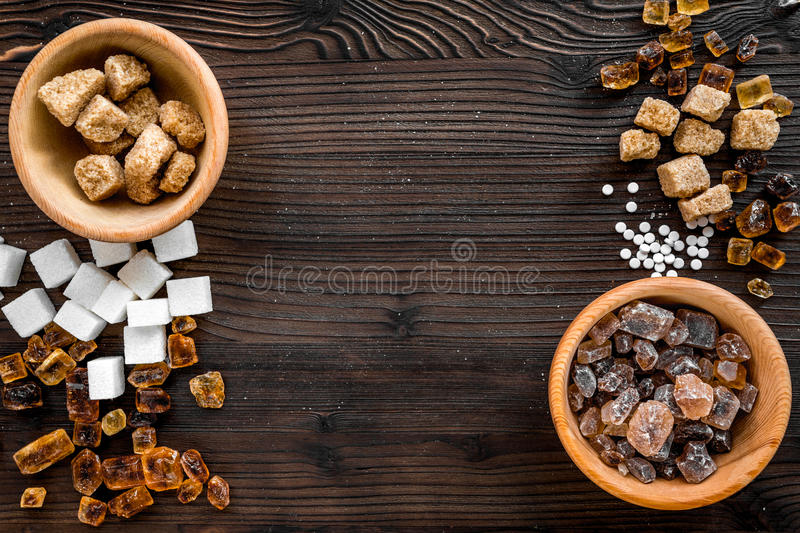 Cooking sweets set with sugar in bowls on kitchen table background top view mock-up. Cooking sweets set with sugar in bowls on kitchen wooden table background stock photos