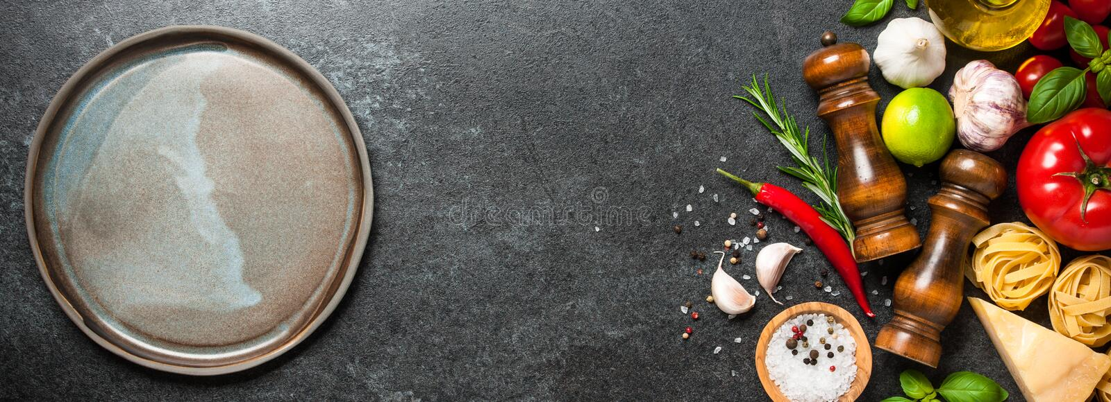 Cooking table with ingredients and empty plate stock photo