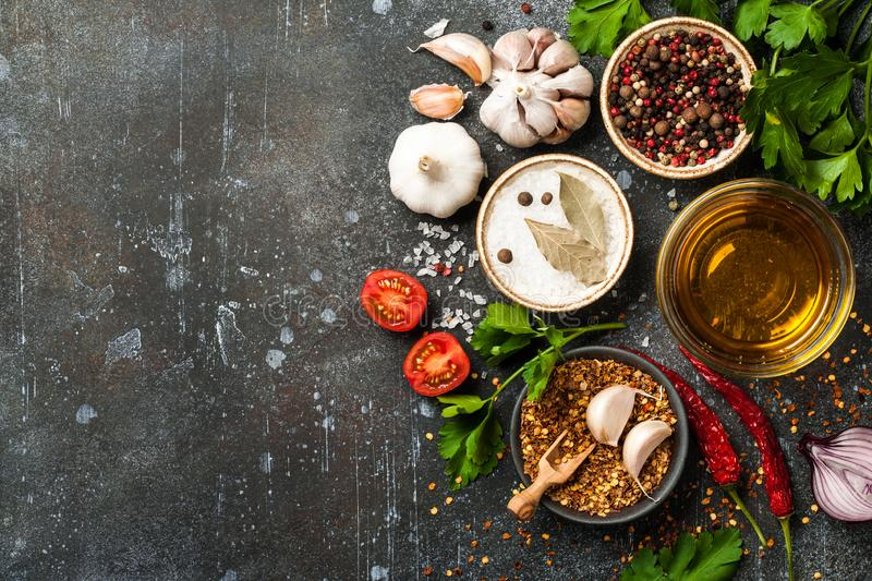 Cooking table with spices and herbs royalty free stock images