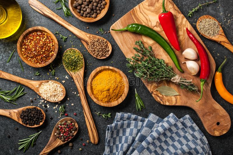 Cooking table with spices and herbs stock photo