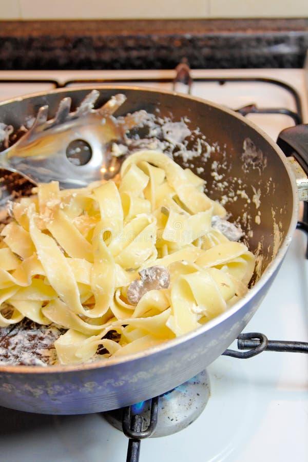 Cooking Tagliatelle Pasta stock photos