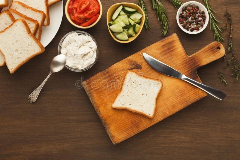Cooking tasty sandwich with cream cheese, top view royalty free stock photo