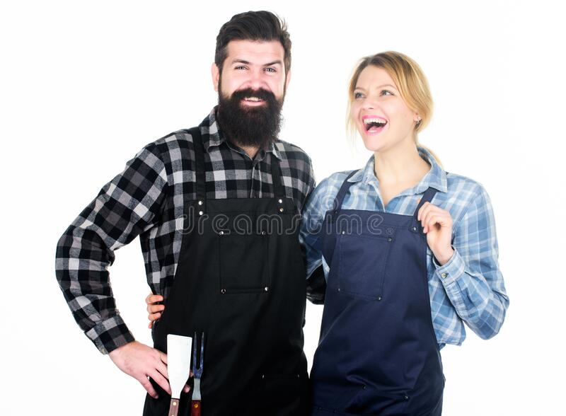 Cooking together. Couple in love getting ready for barbecue. Man bearded guy and girl ready for barbecue white. Background. Picnic and barbecue. Backyard royalty free stock photos
