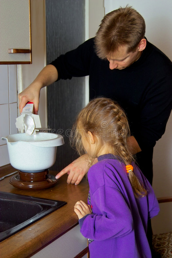 Cooking together with father royalty free stock image