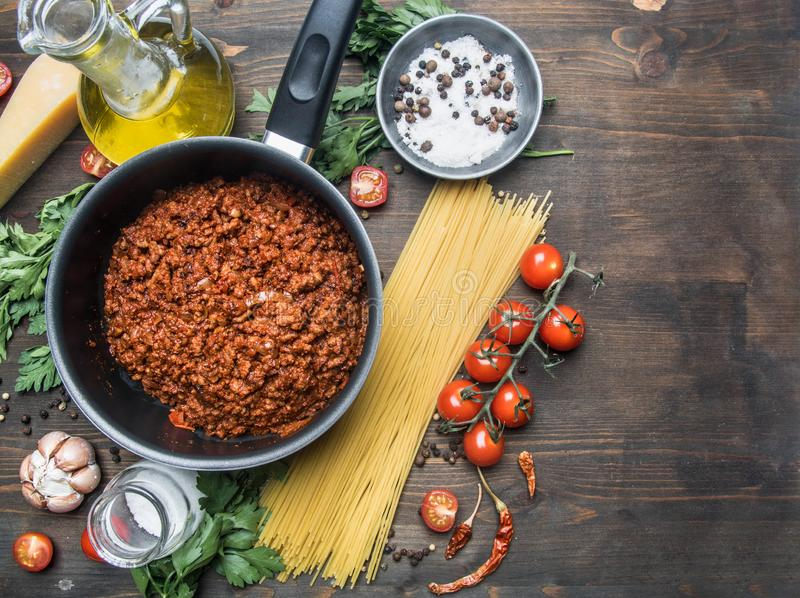Cooking tomato paste with minced meat, cherry tomatoes, parsley, onion and garlic, butter, tomato paste cheese, the ingredient royalty free stock image