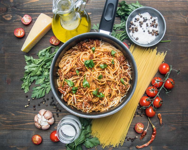 Cooking tomato paste with minced meat, cherry tomatoes, parsley, onion and garlic, butter, tomato paste cheese, the ingredient stock photos