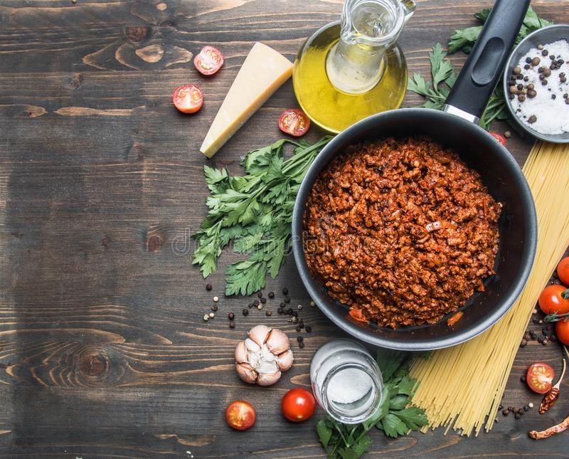 Cooking tomato paste with minced meat, cherry tomatoes, parsley, onion and garlic, butter, tomato paste cheese, the ingredient stock image
