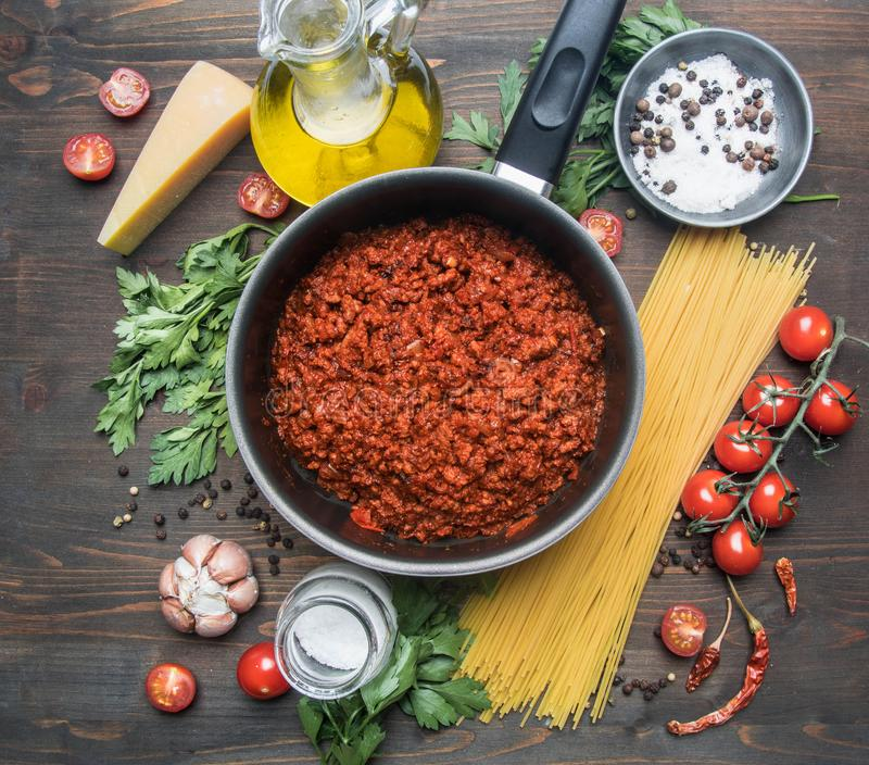 Cooking tomato paste with minced meat, cherry tomatoes, parsley, onion and garlic, butter, tomato paste and cheese, the ingredient stock photography