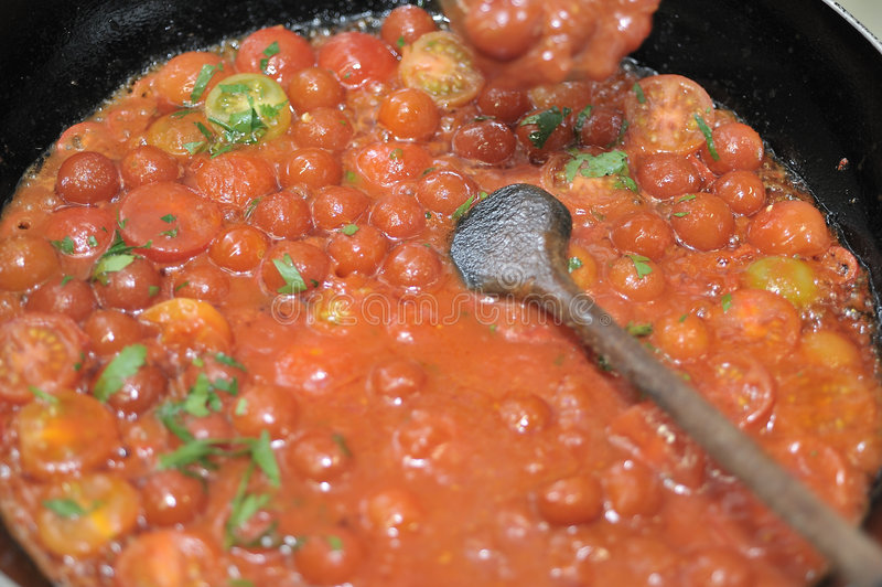 Cooking tomatoes stock photography