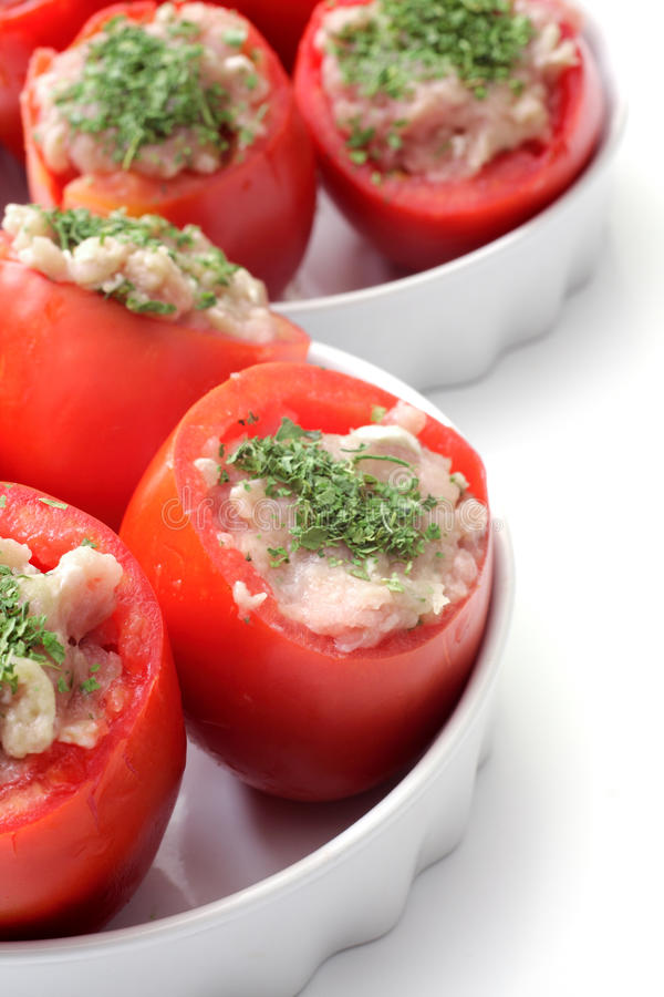 Cooking tomatoes stuffed with chicken meat stock photo