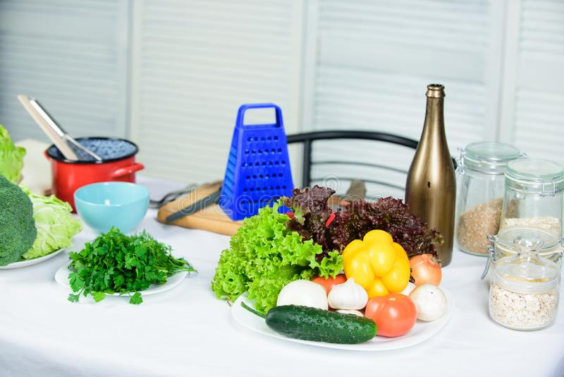Cooking vegetables useful tips. Table with culinary utensils and vegetables ingredients. Welcome to world of tastes stock images