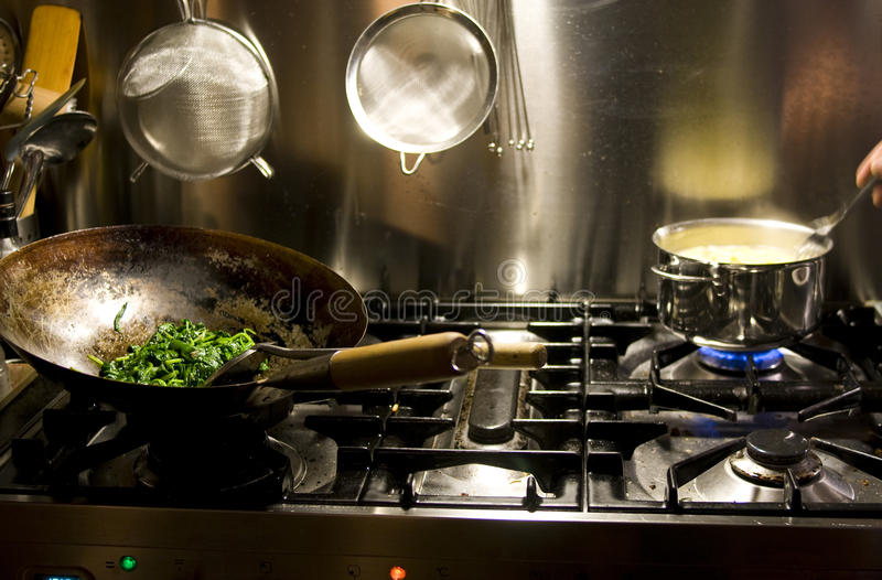 Cooking with wok royalty free stock photography