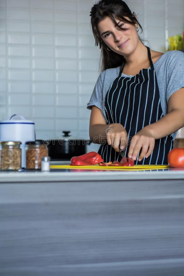 Cooking woman in kitchen stock images