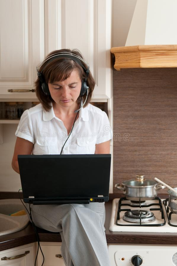 Cooking and working from home royalty free stock image
