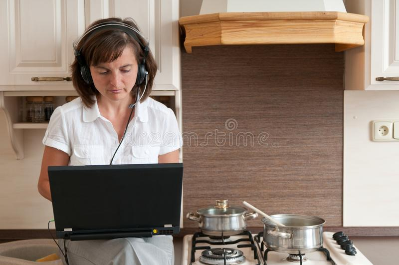 Cooking and working from home stock photography