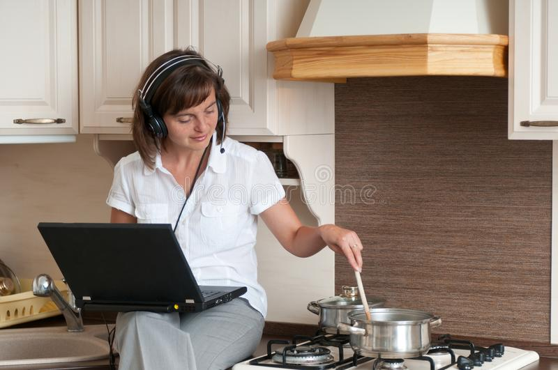 Cooking and working from home stock photos