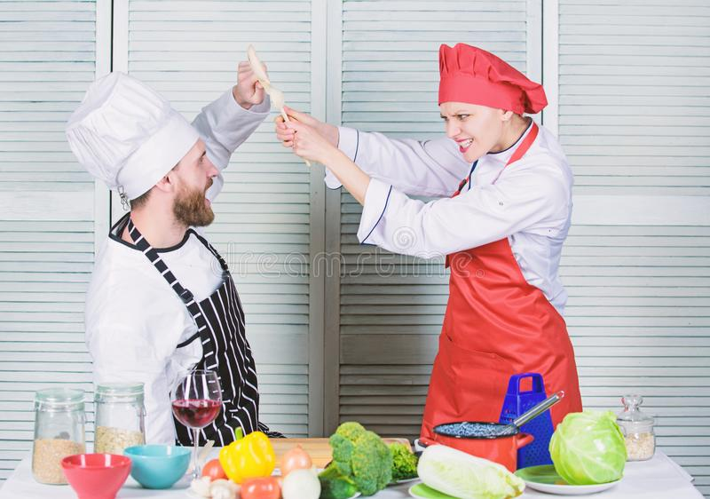Cooking with your spouse can strengthen relationships. Couple compete in culinary arts. Woman and bearded man culinary stock photos
