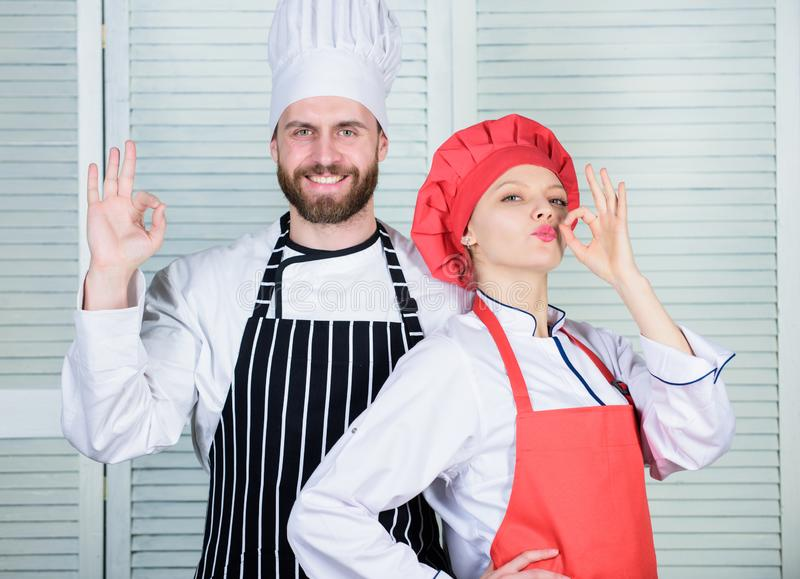 Cooking with your spouse can strengthen relationships. Teamwork in kitchen. Couple cooking dinner. Woman and bearded man stock images