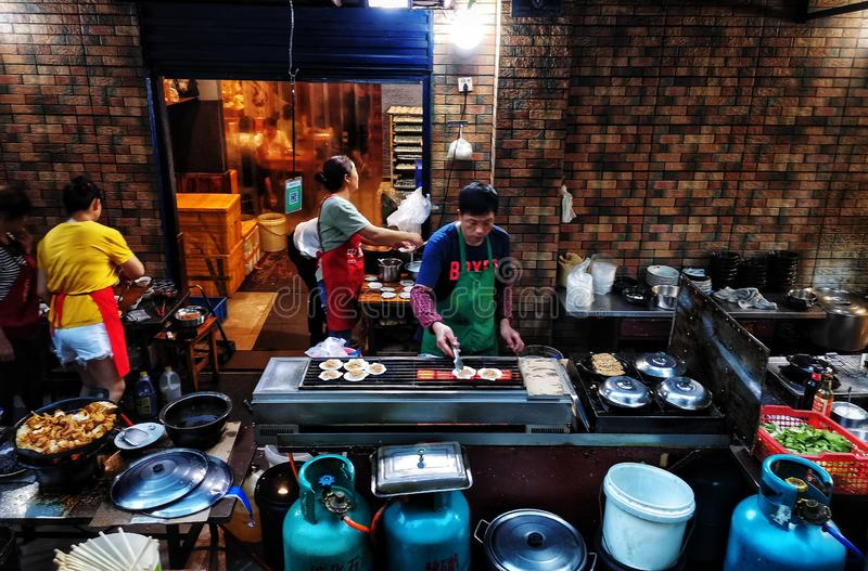The cook is busy at the snack stand in wuhan ciy stock photo