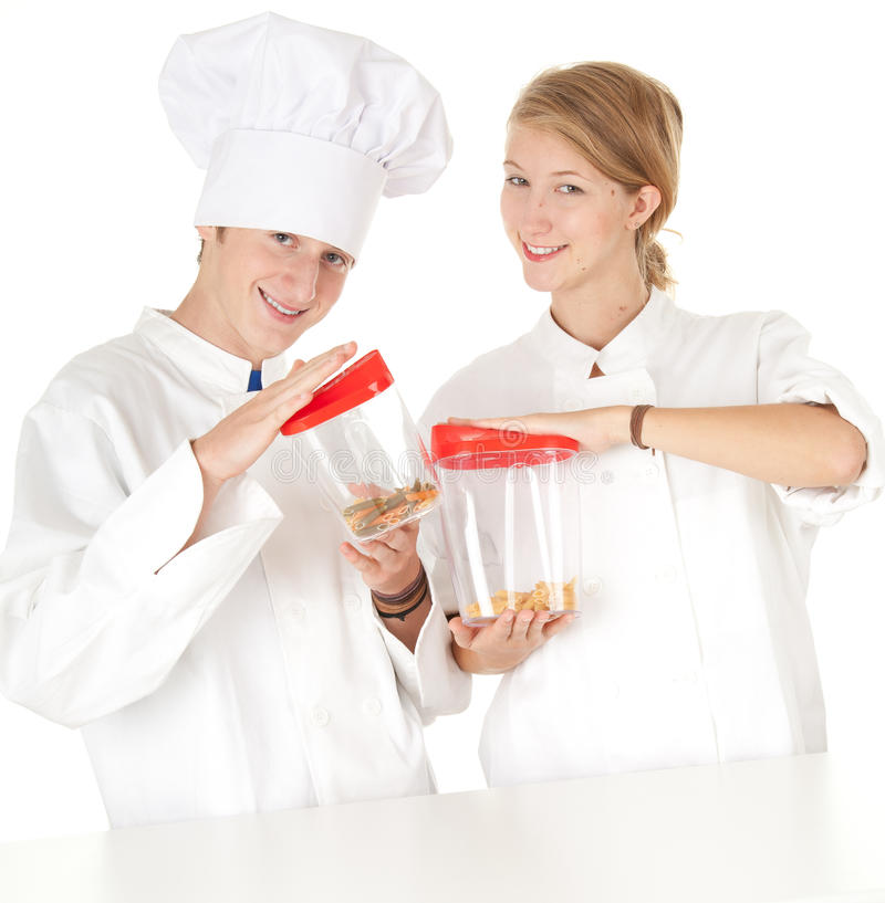 Cooks team, series. Cooks team in white uniforms with plastic boxes, white background, series royalty free stock photos