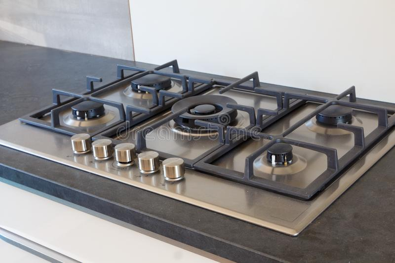 Cooktop in a kitchen. Cooktop with five burners in a modern kitchen royalty free stock images