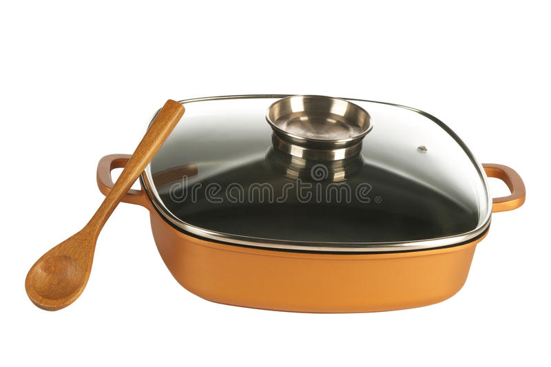 Cookware, nonstick pan and wooden spoon. Cookware, cast iron cooking pot, nonstick pan and glass lid isolated on white stock photography
