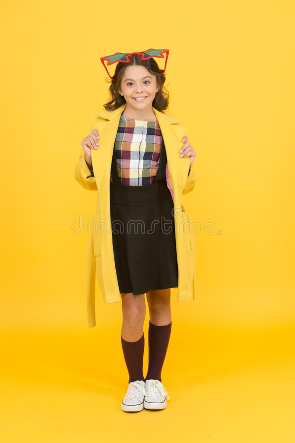 Cool accessory enhances party look. Happy child with cool look. Cool girl in school style yellow background. Fashion kid royalty free stock images