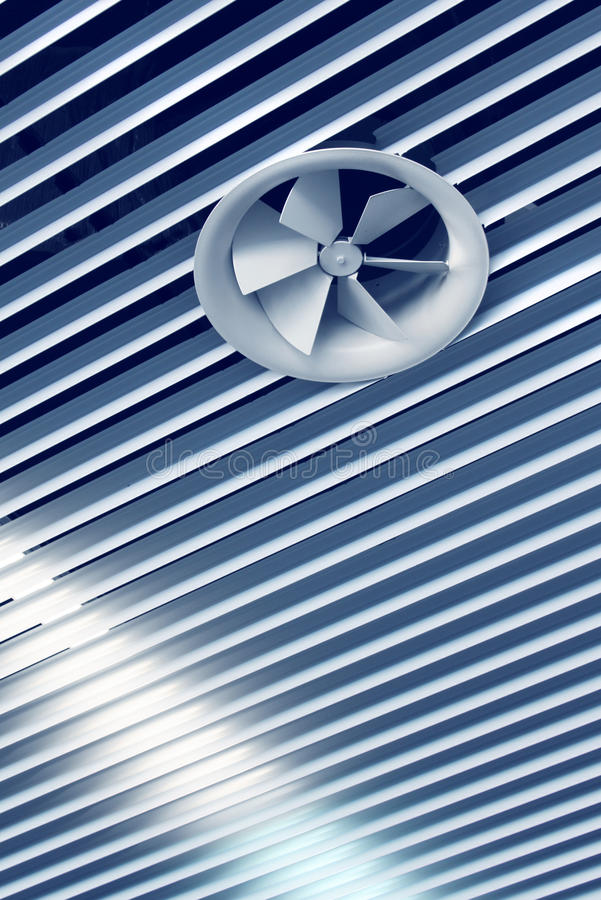Cool air vent fan. Air conditioning cool air vent fan on ceiling royalty free stock photography