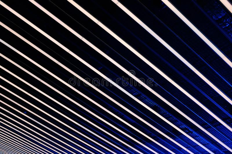Cool background or wallpaper with white lines on black and blue lights royalty free stock image