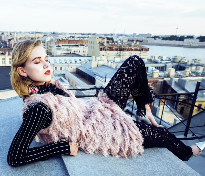 Cool blond real girl friends making selfie on roof top, lifestyl. E people concept, modern fashion teen close up stock images