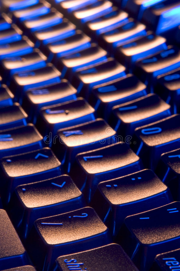Cool, blue and orange keyboard stock photo