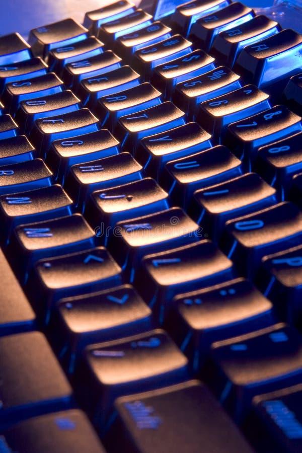 Cool, blue and orange keyboard stock image
