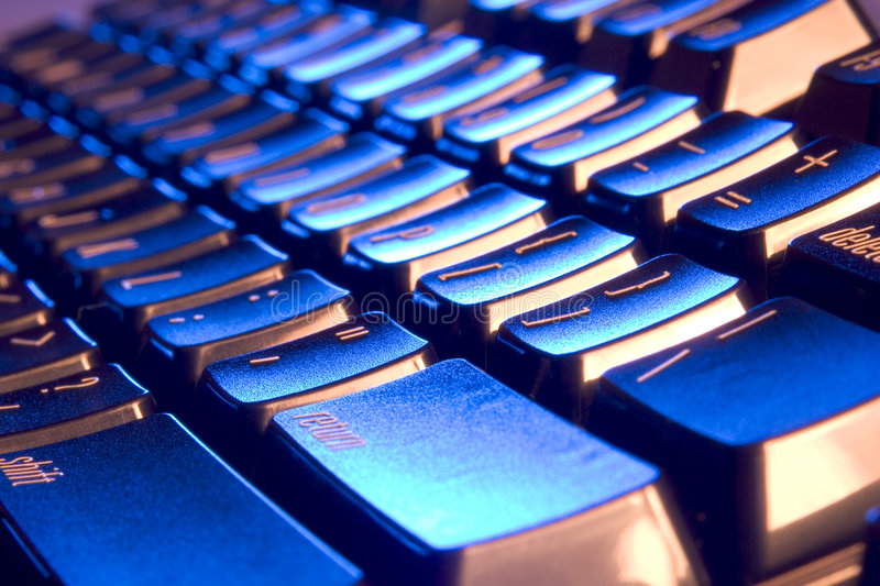 Cool, blue and orange keyboard stock images
