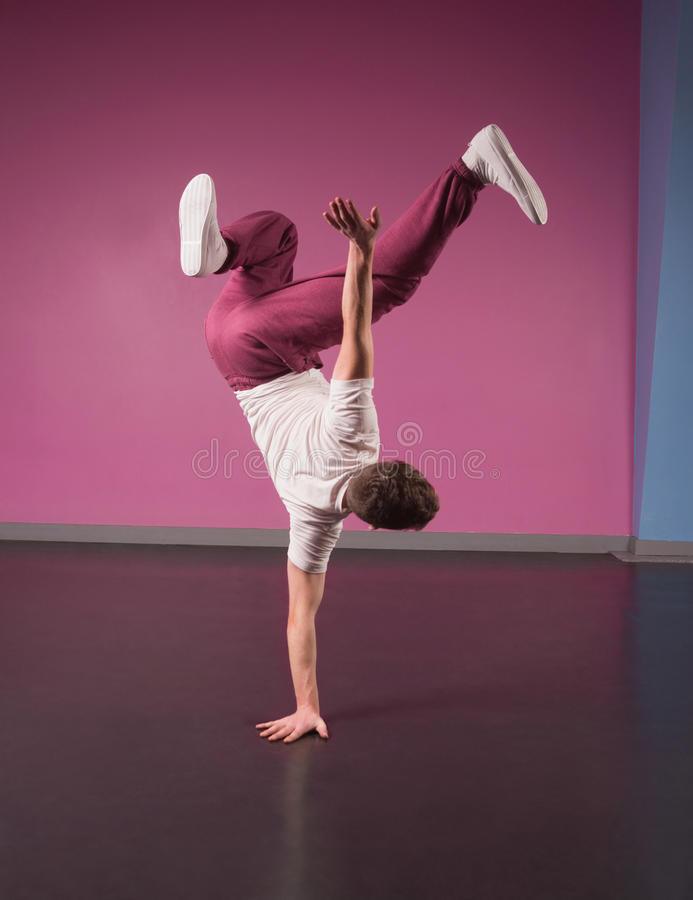 Cool break dancer doing handstand on one hand stock images