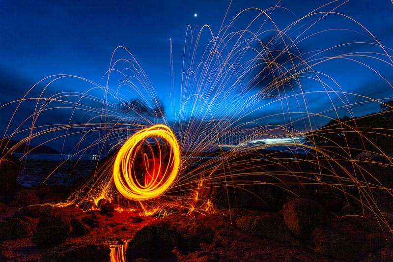 steel wool fire work on the rock royalty free stock photos