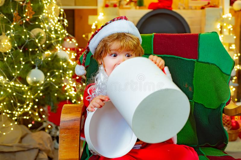 Cool Christmas surprise. Happy boy opened a gift. A dream for children. Christmas gifts for happiness. royalty free stock photos