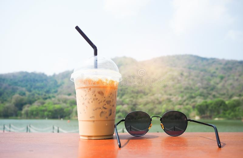 Cool coffee and sunglasses are placed on the table. stock photo