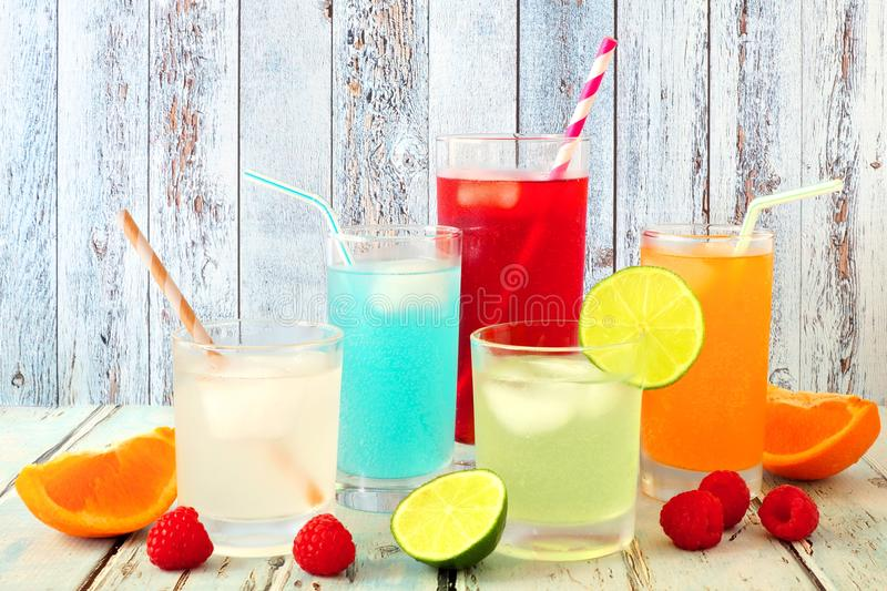 Cool colorful summer drinks against rustic wood. Group of cool colorful summer drinks against a rustic wood background royalty free stock images